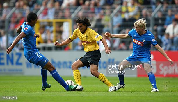 Nelson Valdez of Dortmund attacks as Luis Gustavo Dias and Andreas Beck of Hoffenheim defend during the Bundesliga match between 1899 Hoffenheim and...