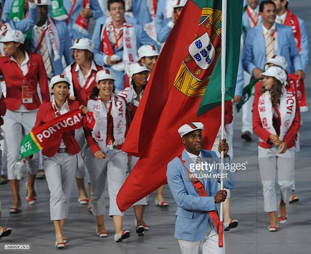 Nelson vora Portugal's flag bearer parades in front of his delegation during the 2008 Beijing Olympic Games opening ceremony on August 8 2008 at the...