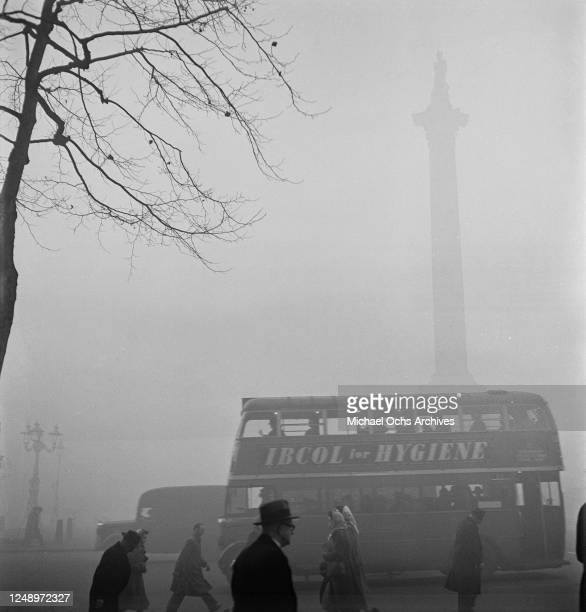 Nelson's Column in Trafalgar Square London in the fog circa 1948 An advertisement on a passing bus recommends 'Ibcol For Hygiene'