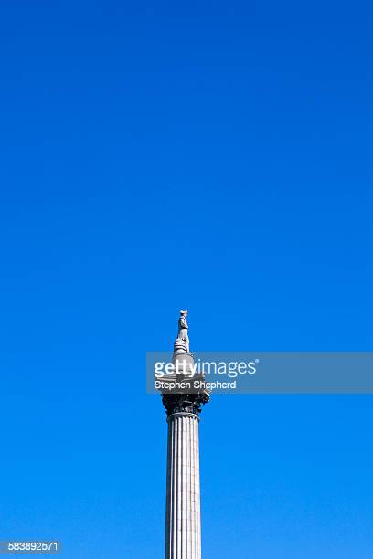 nelsons column london and blue sky.\ - nelson's column stock photos and pictures