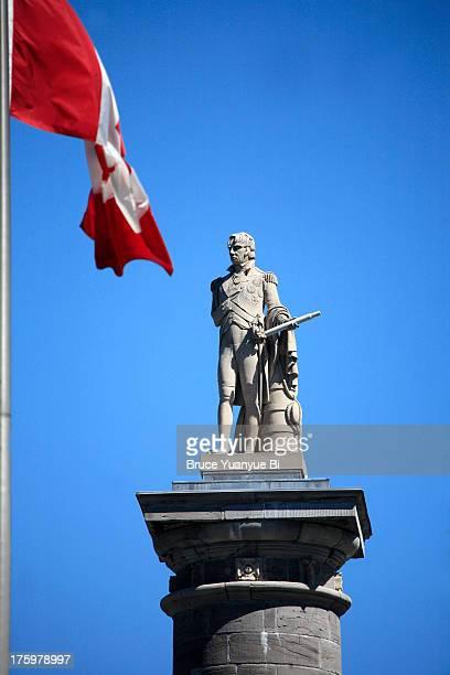 nelson's column with flags - ジャック カルティエ ストックフォトと画像