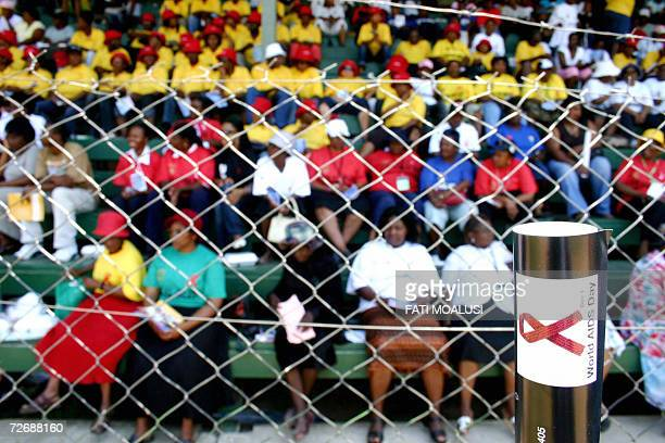 Nelspruit, SOUTH AFRICA: Nelspruit residents attend a World AIDS day event, 01 December 2006, at Kwa Nyamazane stadium in Nelspruit, South Africa....