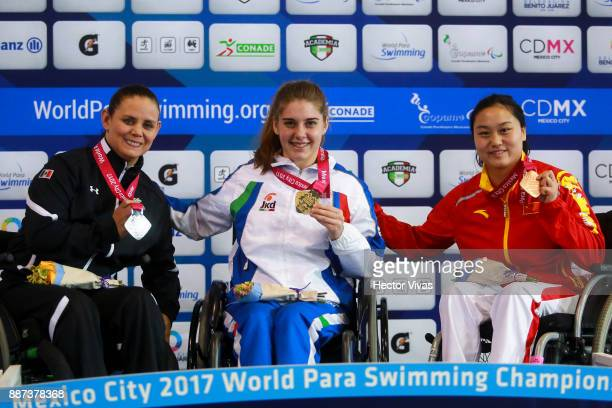 Nely Miranda of Mexico Monica Boggioni of Italy and Cheng Jiao of China pose after the Women's 50m Freestyle S4 Final during day 5 of the Para...