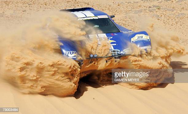 JeanLouis Schlesser drives his SchlesserFord to win the ninth stage of the 29th Dakar between Tichit and Nema 15 January 2007 France's Stephane...