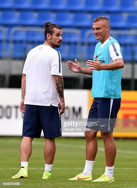 Nemaja Vidic and Pablo Daniel Osvaldo of FC Internazionale during a training session at Appiano Gentile on August 8 2014 in Como Italy