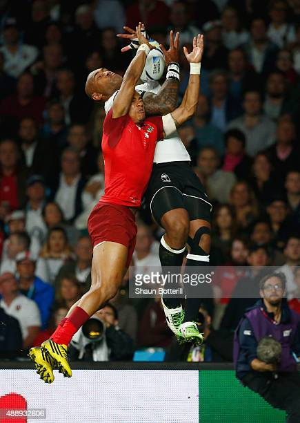 Nemani Nadolo of Fiji scores a try under pressure from Anthony Watson of England during the 2015 Rugby World Cup Pool A match between England and...