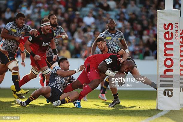 Nemani Nadolo of the Crusaders breaks through the Brumbies defence to score a try during the round nine Super Rugby match between the Brumbies and...