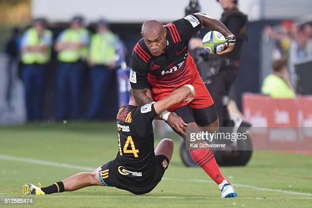 Nemani Nadolo of the Crusaders is tackled by Shaun Stevenson of the Chiefs during the round one Super Rugby match between the Crusaders and the...
