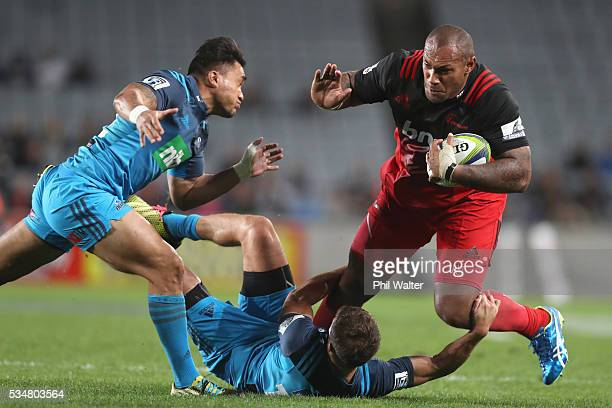 Nemani Nadolo of the Crusaders is tackled during the round 14 Super Rugby match between the Blues and the Crusaders at Eden Park on May 28 2016 in...
