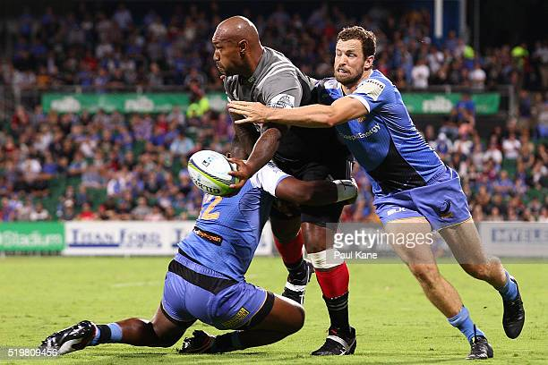 Nemani Nadolo of the Crusaders looks to offload the ball during the round seven Super Rugby match between the Force and the Crusaders at nib Stadium...
