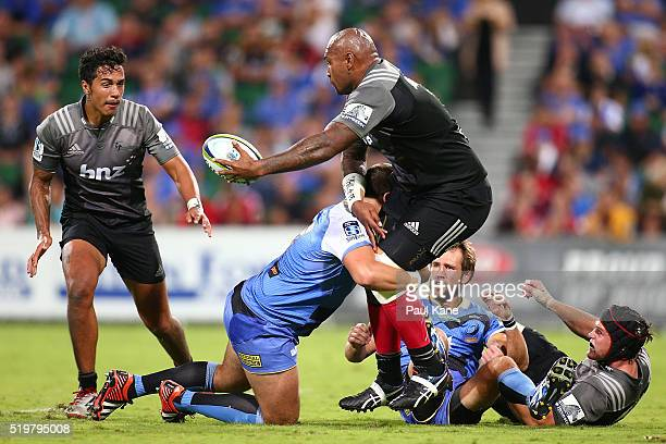 Nemani Nadolo of the Crusaders offloads the ball during the round seven Super Rugby match between the Force and the Crusaders at nib Stadium on April...