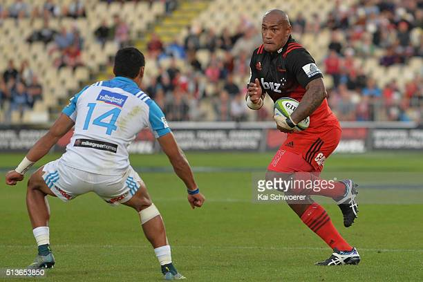 Nemani Nadolo of the Crusaders runs with the ball during the round two Super Rugby match between the Crusaders and the Blues at AMI Stadium on March...