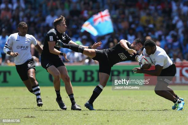 Nemani Nagusa of Fiji is tackled by Tim Mikkelson of New Zealand during the Cup Quarter Final match between New Zealand and Fiji in the 2017 HSBC...