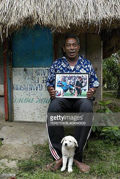 Nemani Rokocoko Moaso age 72 holds a photo of his grandson Fijianborn All Black winger Joseph Rokocoko outside the family bure in the back road...
