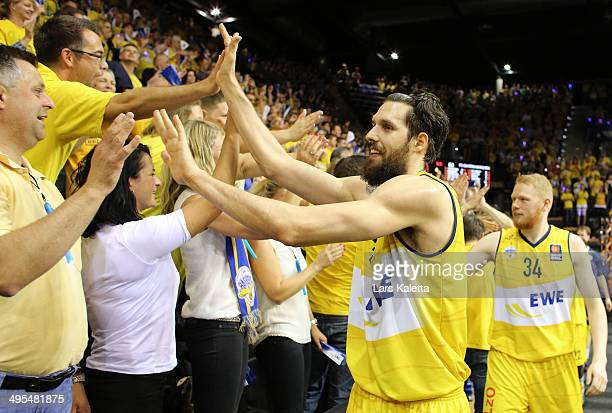 Nemanja Aleksandrov and Philipp Neumann of Oldenburg celebrate with the fans after game four of the 2014 Beko BBL Playoffs SemiFinal between EWE...
