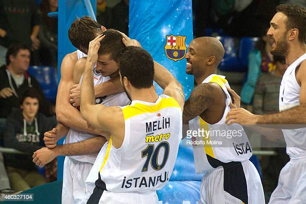 Nemanja Bjelica #8 of Fenerbahce Ulker Istanbul is congratulated by teamates at the end of the 20142015 Turkish Airlines Euroleague Basketball...