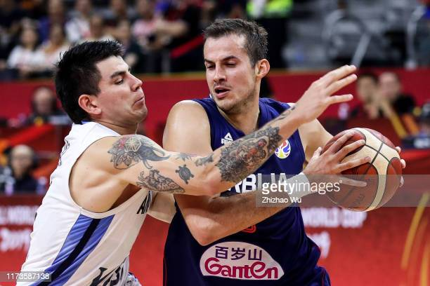 Nemanja Bjelica of Serbia drives against Gabriel Deck during the quarter final of 2019 FIBA World Cup between Argentina and Serbia at Dongguan...