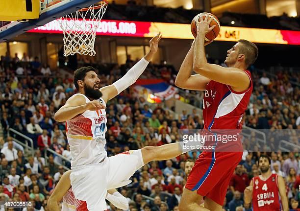 Nemanja Bjelica of Serbia drives to the basket against Nikola Mirotic of Spain during the FIBA EuroBasket 2015 Group B basketball match between Spain...