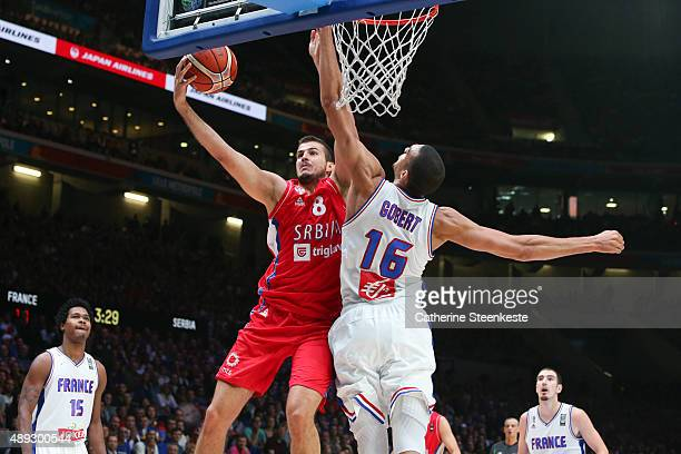 Nemanja Bjelica of Serbia goes up to the basket against Rudy Gobert of France during the EuroBasket 3rd place game between France v Serbia at Stade...