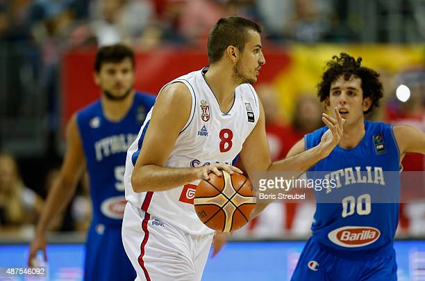Nemanja Bjelica of Serbia looks to pass the ball during the FIBA EuroBasket 2015 Group B basketball match between Serbia and Italy at Arena of...