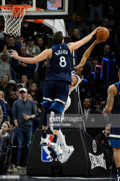 Nemanja Bjelica of the Minnesota Timberwolves blocks a shot by Quinn Cook of the Golden State Warriors during the game on March 11 2018 at the Target...