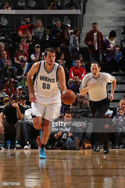 Nemanja Bjelica of the Minnesota Timberwolves brings the ball up court against the Toronto Raptors at Canadian Tire Centre on October 14 2015 in...