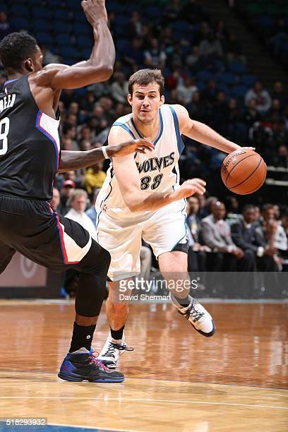 Nemanja Bjelica of the Minnesota Timberwolves drives to the basket against Jeff Green of the Los Angeles Clippers on March 30 2016 at Target Center...