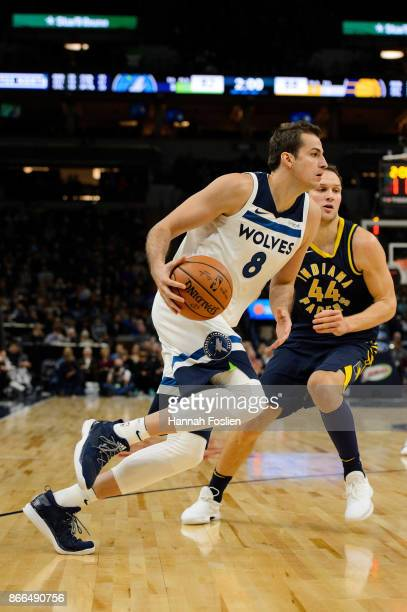 Nemanja Bjelica of the Minnesota Timberwolves drives to the basket against Bojan Bogdanovic of the Indiana Pacers during the game on October 24 2017...
