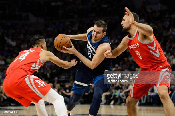 Nemanja Bjelica of the Minnesota Timberwolves drives to the basket against Gerald Green and Ryan Anderson of the Houston Rockets in Game Four of...