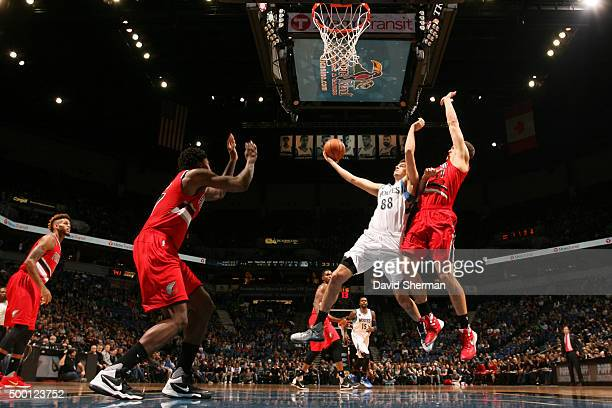 Nemanja Bjelica of the Minnesota Timberwolves goes for the layup against the Portland Trail Blazers during the game on December 5 2015 at Target...