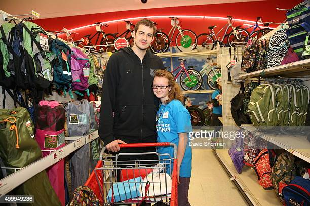 Nemanja Bjelica of the Minnesota Timberwolves goes shopping for holiday gifts with kids who are up for adoption through the Minnesota Timberwolves...