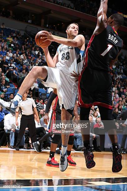 Nemanja Bjelica of the Minnesota Timberwolves goes to the basket against Chris Bosh of the Miami Heat on November 5 2015 at Target Center in...
