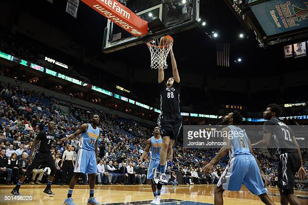 Nemanja Bjelica of the Minnesota Timberwolves goes to the basket against the Denver Nuggets on December 15 2015 at Target Center in Minneapolis...