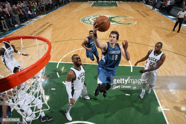 Nemanja Bjelica of the Minnesota Timberwolves goes to the basket against the Milwaukee Bucks on March 11 2017 at the BMO Harris Bradley Center in...