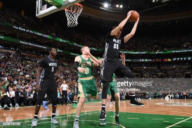 Nemanja Bjelica of the Minnesota Timberwolves grabs the rebound against the Boston Celtics on March 15 2017 at the TD Garden in Boston Massachusetts...