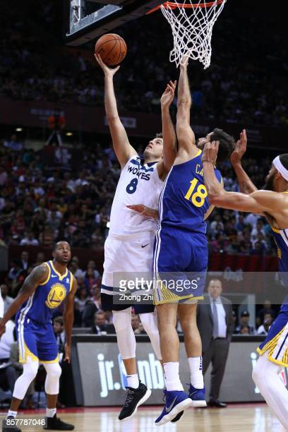 Nemanja Bjelica of the Minnesota Timberwolves in action against Omri Casspi of the Golden State Warriors during the game between the Minnesota...