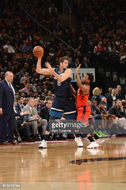 Nemanja Bjelica of the Minnesota Timberwolves passes the ball during the game against the Toronto Raptors on January 30 2018 at the Air Canada Centre...