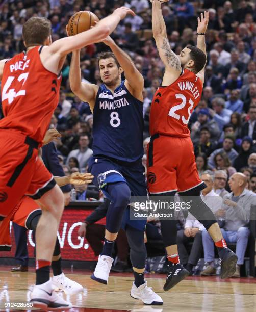 Nemanja Bjelica of the Minnesota Timberwolves plays against Fred VanVleet of the Toronto Raptors in an NBA game at the Air Canada Centre on January...