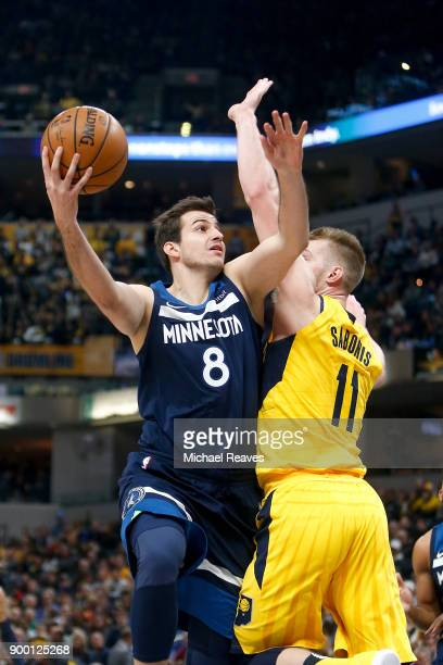 Nemanja Bjelica of the Minnesota Timberwolves puts up a layup over Domantas Sabonis of the Indiana Pacers during the first half at Bankers Life...