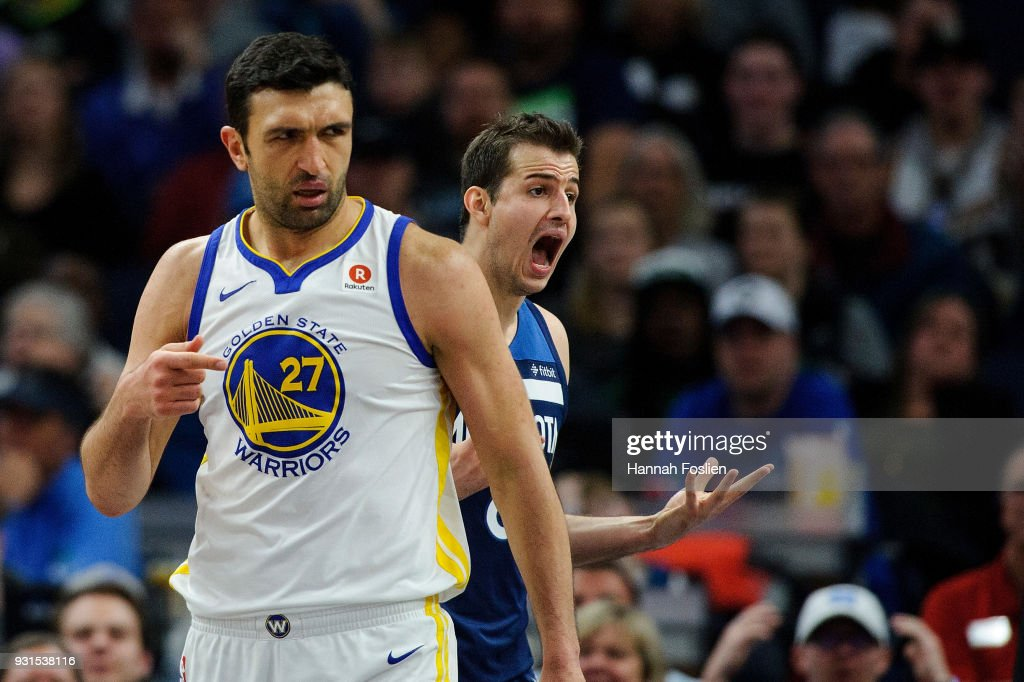 Nemanja Bjelica #8 of the Minnesota Timberwolves reacts to being called for a foul as Zaza Pachulia #27 of the Golden State Warriors looks on during the game on March 11, 2018 at the Target Center in Minneapolis, Minnesota.