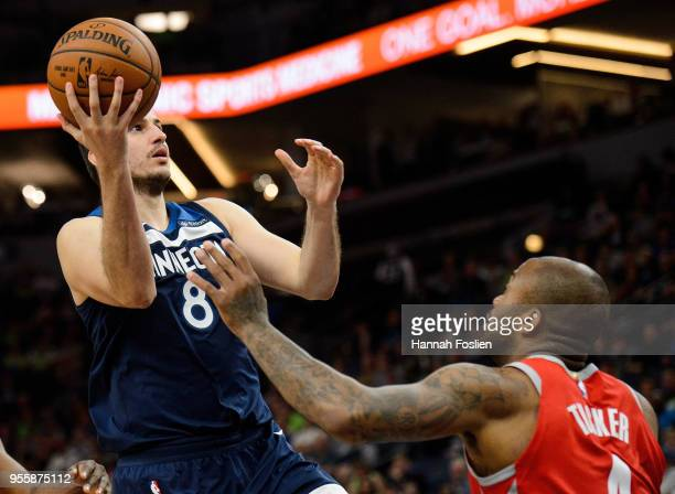 Nemanja Bjelica of the Minnesota Timberwolves shoots the ball against PJ Tucker of the Houston Rockets in Game Four of Round One of the 2018 NBA...