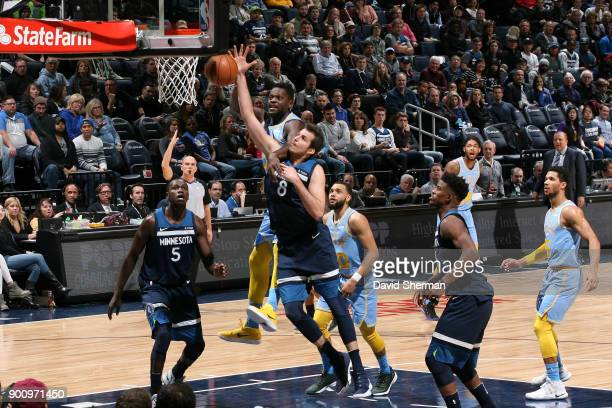 Nemanja Bjelica of the Minnesota Timberwolves tries to rebound ball against Julius Randle of the Los Angeles Lakers on January 1 2018 at Target...