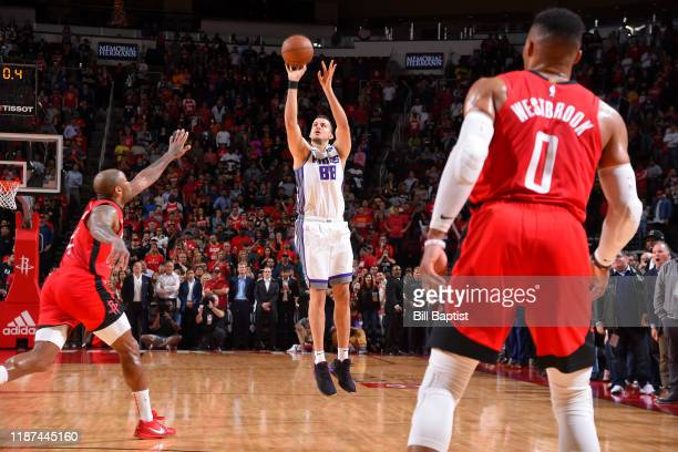Nemanja Bjelica of the Sacramento Kings shoots the 3point shot to win the game against the Houston Rockets on December 09 2019 at the Toyota Center...