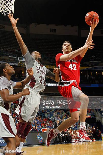 Nemanja Djurisic of the Georgia Bulldogs shoots the ball over Arnett Moultrie of the Mississippi State Bulldogs during the first round of the SEC...