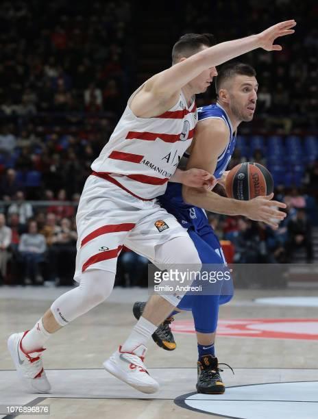 Nemanja Gordic of Buducnost Voli Podgorica dribbles into the defense of Dairis Bertans of AX Armani Exchange Olimpia Milan during the Turkish...