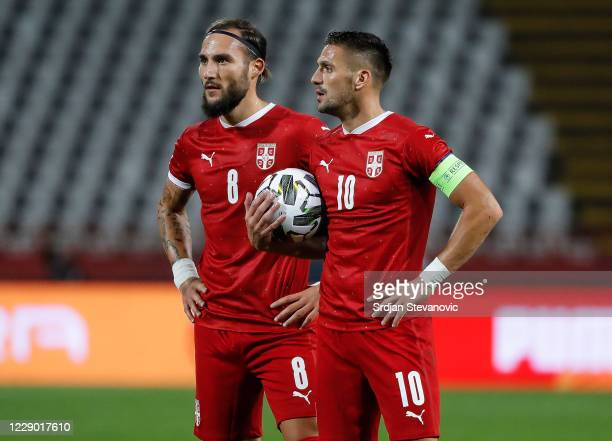 Nemanja Gudelj and Dusan Tadic of Serbia look on during the UEFA Nations League group stage match between Serbia and Hungary at Rajko Mitic Stadium...
