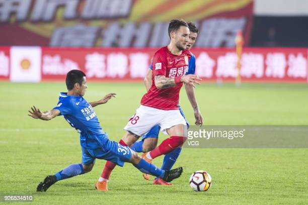 Nemanja Gudelj of Guangzhou Evergrande and Chen Zhizhao of Guangzhou RF compete for the ball during the 2018 Chinese Football Association Super...