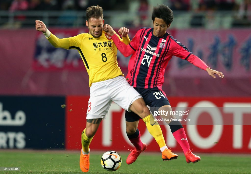 Nemanja Gudelj of Guangzhou Evergrande and Kazuya Yamamura of Cerezo Osaka compete for the ball during the AFC Champions League Group G match between Cerezo Osaka and Gunazhou Evergrande at the Yanmar Stadium Nagai on February 21, 2018 in Osaka, Japan.