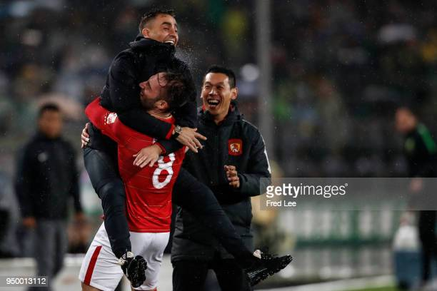 Nemanja Gudelj of Guangzhou Evergrande Taobao celebrates scoring his team's goal with Head coach Fabio Cannavaro during 2018 China Super League match...