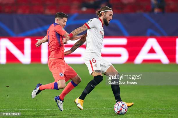 Nemanja Gudelj of Sevilla FC competes for the ball with Jorginho of Chelsea FC during the UEFA Champions League Group E stage match between FC...